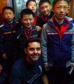 western foreigner with local North Korea schoolchildren Pyongyang in metro