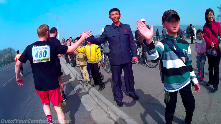 North Koreans giving high five to foreigners