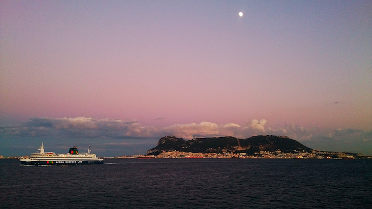 view of Gibraltar from ferry straight of Gibraltar sunset